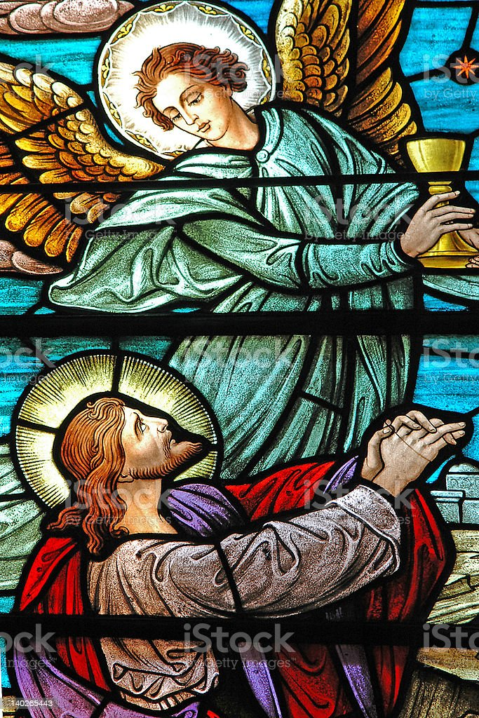 Stained glass window of Jesus and Angel stock photo