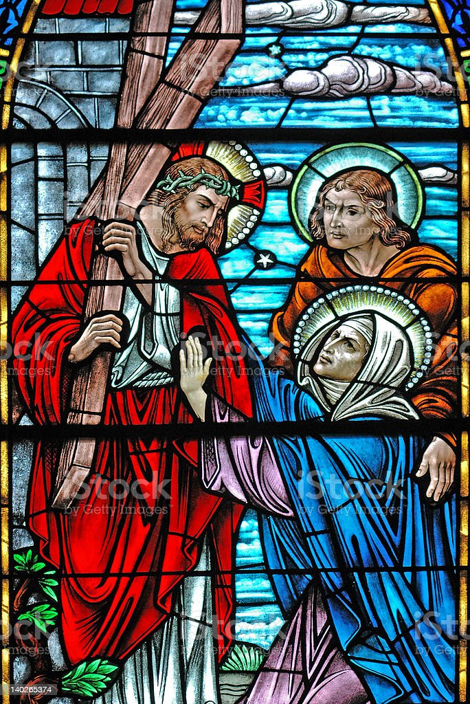 Stained glass window of Jesus carrying cross stock photo