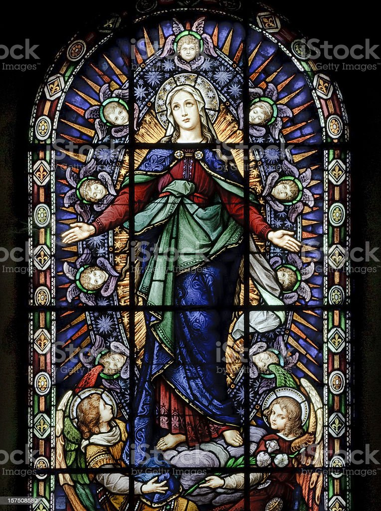 A stained glass window of Santa Maria stock photo