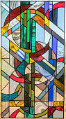 Abstract Geometric Yin Yang Leaded Stained Glass Panel Hanging over a Window.