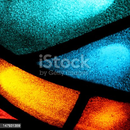 Close-up of a backlit stained glass window