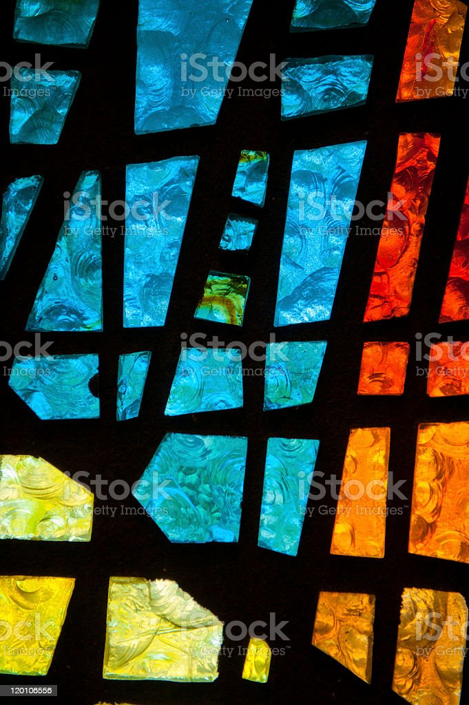 Stained glass window with geometric patterns of glass stock photo