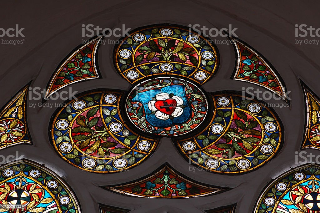 stained glass window with Luther rose symbol stock photo