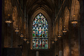 Stained Glass Windows in the main hall of St Giles` Cathedral. The Gothic Church in the center of old town of Edinburgh, Scotland