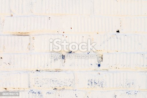 istock Stained old grunge white brick wall with plaster. For modern background, pattern, wallpaper or banner design, place for your text 668289276