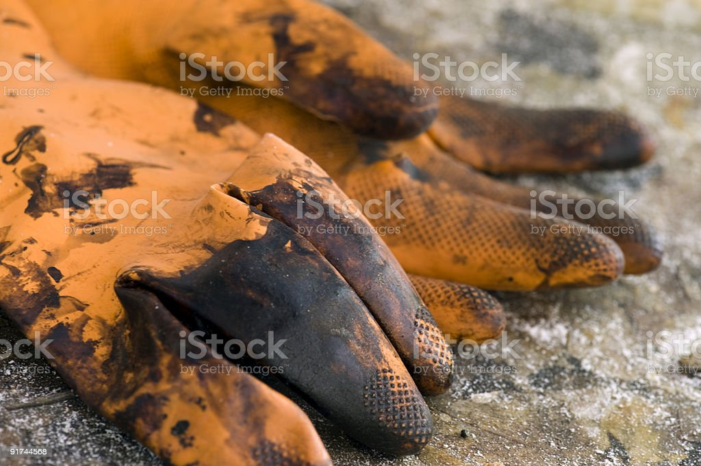Stained Orange Gloves stock photo