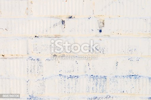 istock Stained white brick wall with plaster close-up. For modern background, pattern, wallpaper or banner design, place for your text 668289206