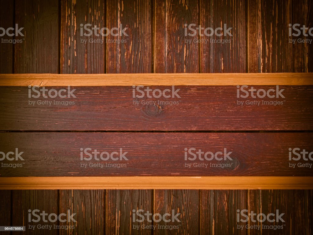 Stained wood planks on old ragged wall royalty-free stock photo