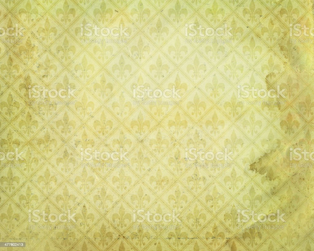stained yellow paper with symbol stock photo