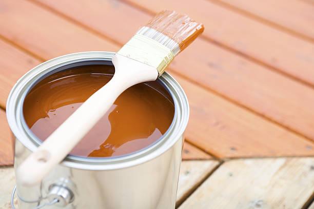 staining hardwood patio deck - houtbeits stockfoto's en -beelden