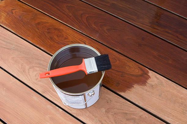 staining hardwood patio decking - houtbeits stockfoto's en -beelden