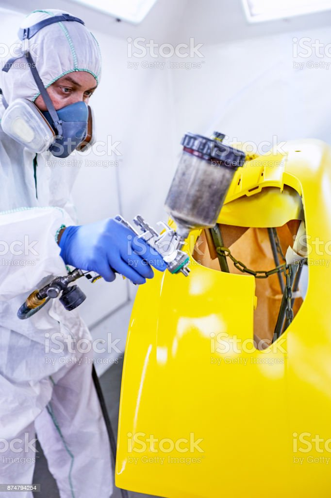 Staining of the car's parts in yellow on the service. stock photo