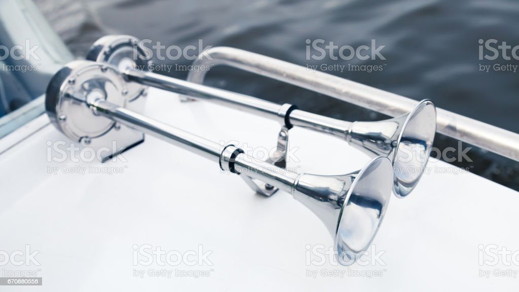 Stainless boat electric horns with chromium trumpet stock photo