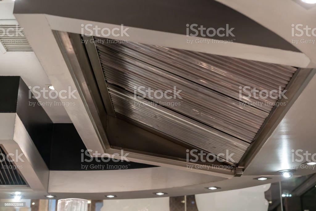 Stainless exhaust hood and ventilation for teppanyaki kitchen restaurant. stock photo