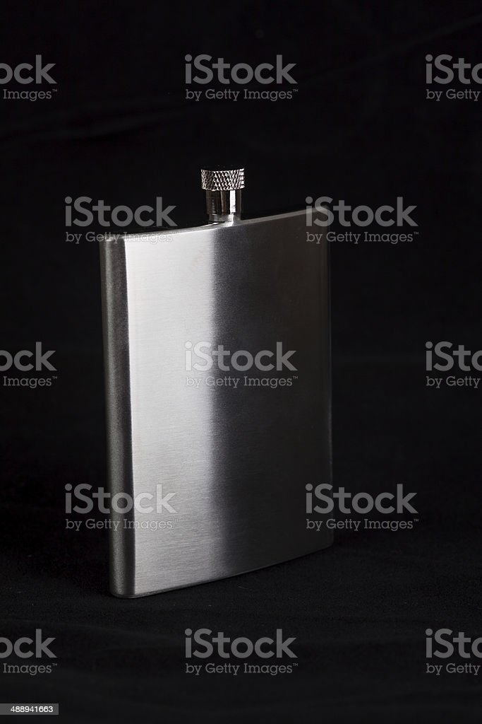 Stainless hip flask on black background royalty-free stock photo