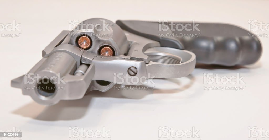 A stainless revolver on a white background stock photo