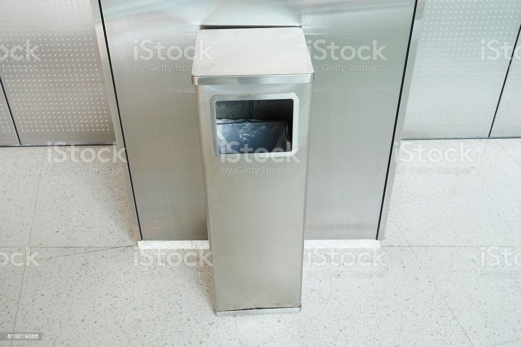 Stainless square bin in front of the elevator. stock photo