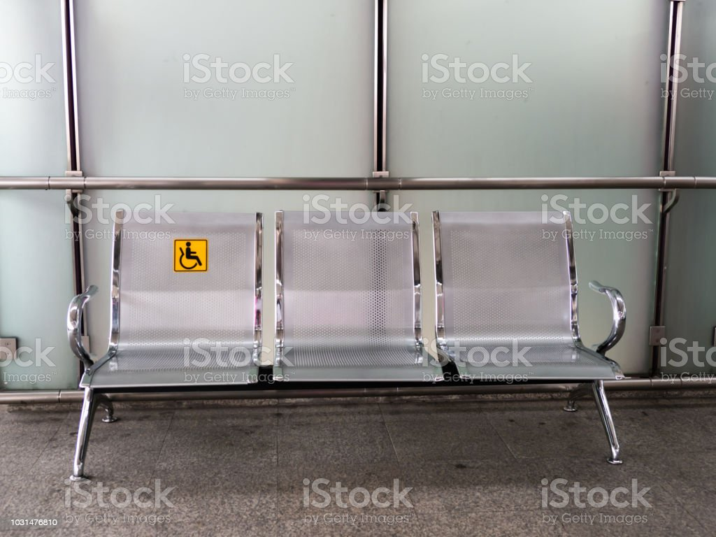 Stainless Steel Chairs In The Train Station With Disabled