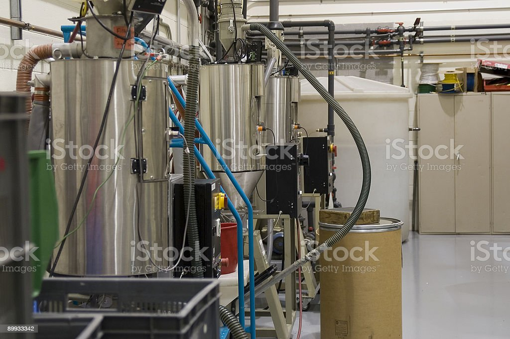 Stainless steel containers - Plastics manufacturing stock photo