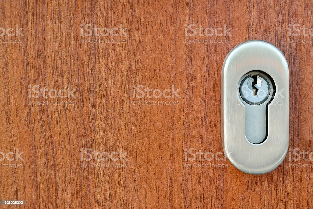 Stainless steel door lock and a Keyhole on the wooden door royalty-free stock photo & Stainless Steel Door Lock And A Keyhole On The Wooden Door stock ... pezcame.com