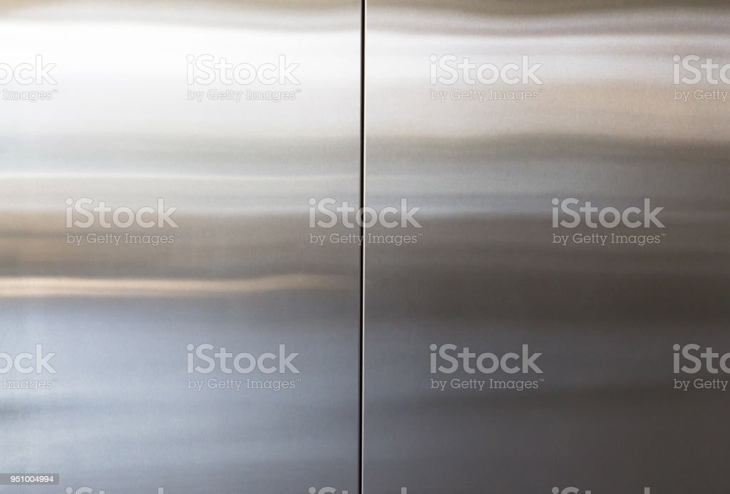 stainless steel elevator door background and texture, silver metal wall panel royalty-free stock photo