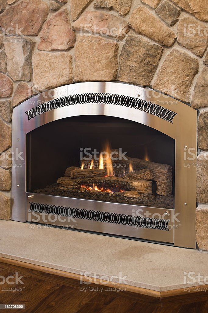 Stainless Steel Gas Fireplace With Rock Surround Stock Photo