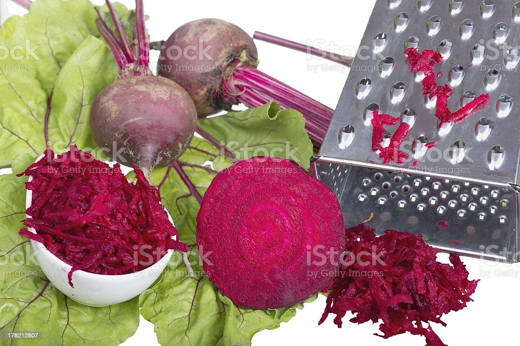 Stainless steel grater and grated beet. royalty-free stock photo