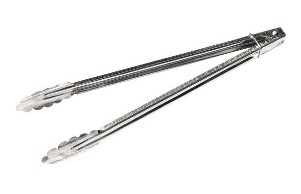 Stainless steel kitchen tongs stock photo