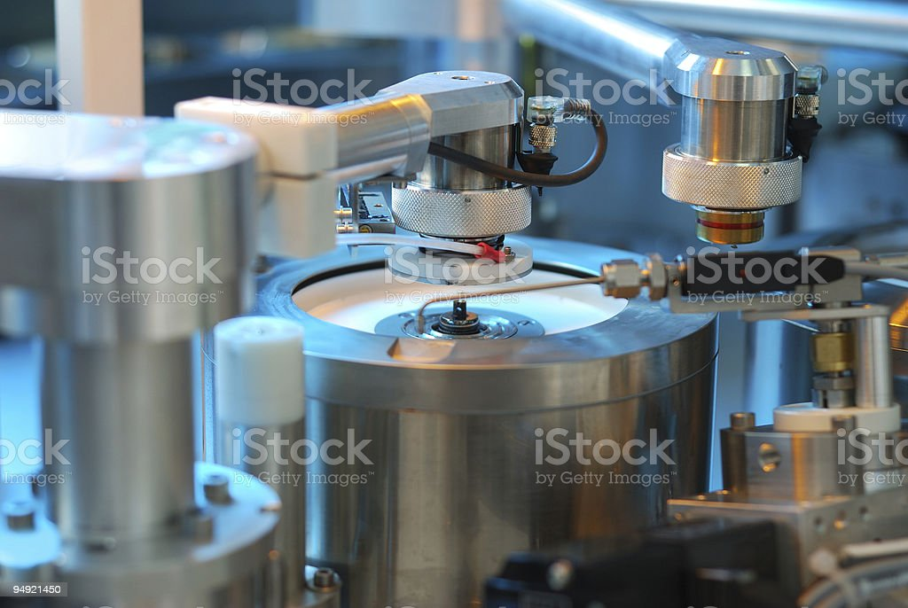 Stainless steel machines making DVDs stock photo