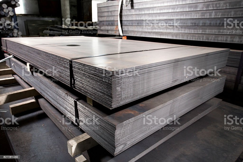 Stainless steel metal sheets deposited in stacks stock photo
