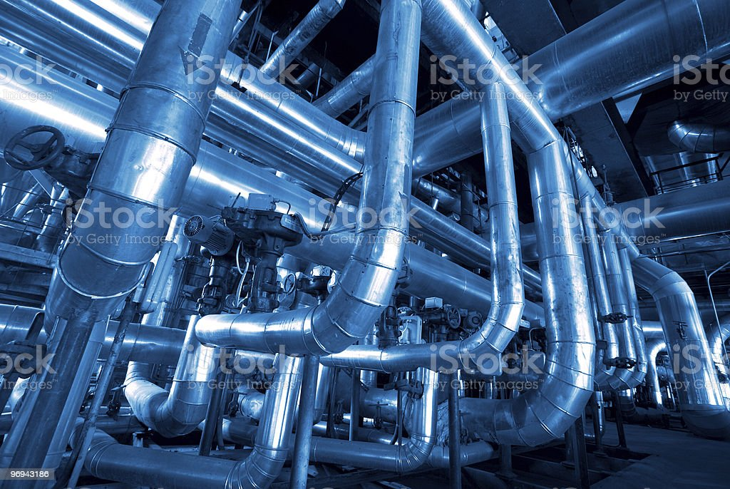 stainless steel pipelines at factory royalty-free stock photo