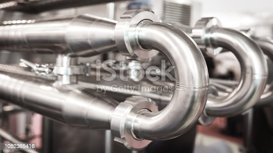 istock Stainless steel pipes in the factory. Construction on food production, Abstract industry background. 1052365416