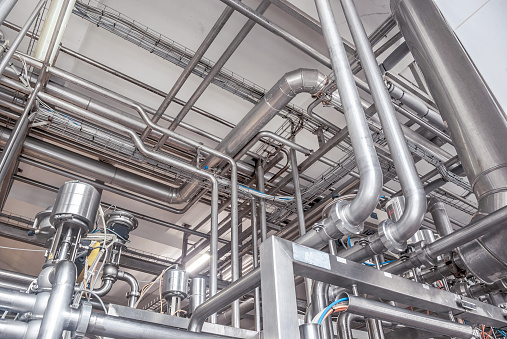 Stainless Steel Pipes In The Factory Construction On Food Production  Abstract Industry Background Stock Photo - Download Image Now