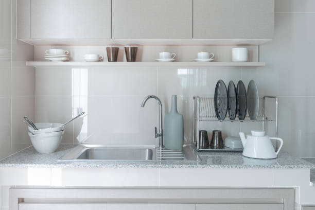 stainless steel sink with faucet on kitchen stock photo