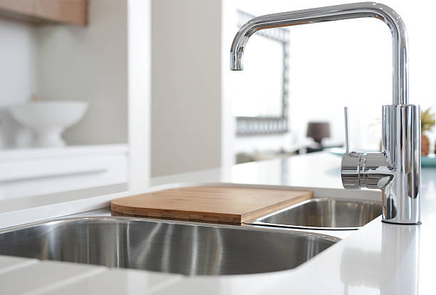 stainless steel sink with mixer tap - fontein stockfoto's en -beelden