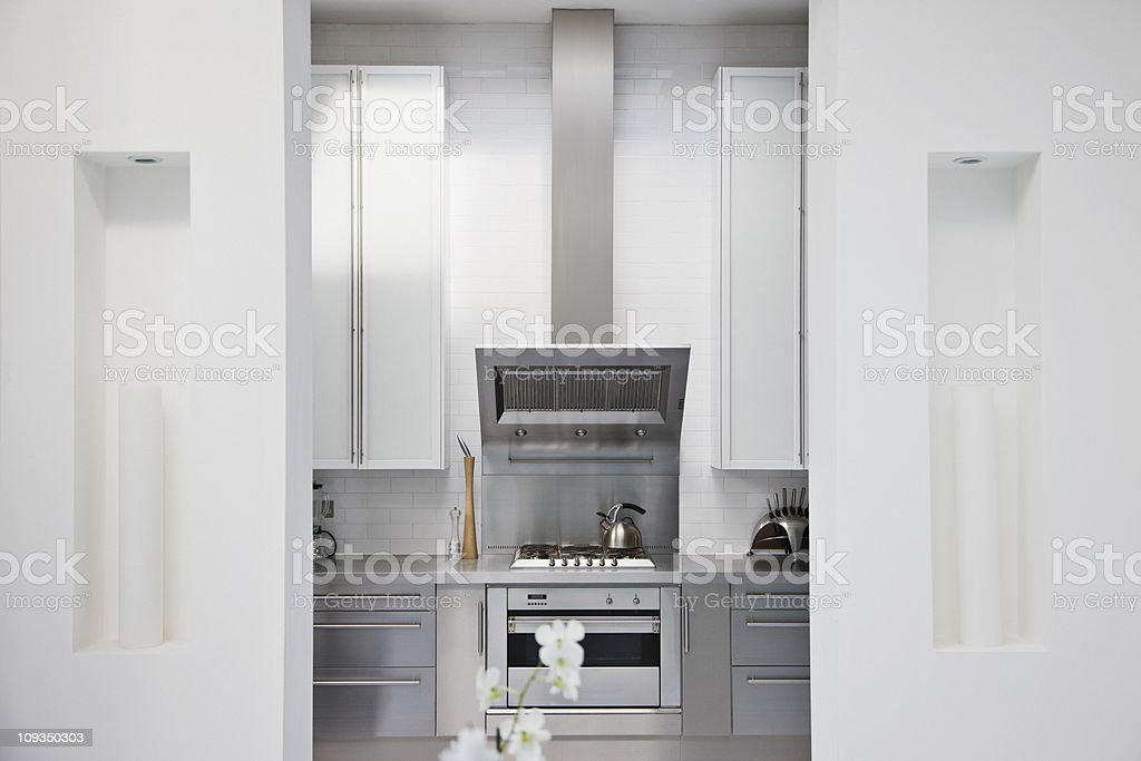 Stainless steel stove in modern white kitchen stock photo