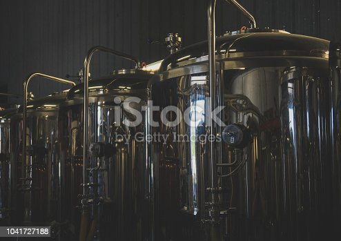 istock Stainless tanks for fermentation in a beer brewery. 1041727188