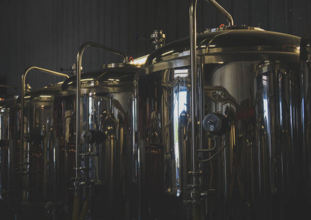 Stainless tanks for fermentation in a beer brewery. stock photo