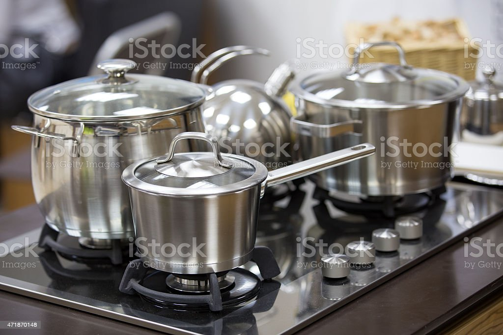 stainless utensils on gas cooker stock photo