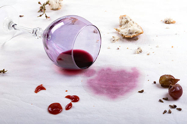 stains on tablecloth of spilled wine glass and food - foto de acervo