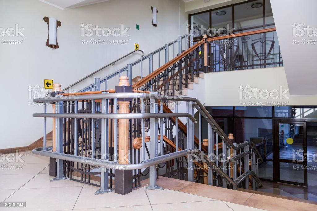 Stair lift for the disabled. Stairs of public building stock photo