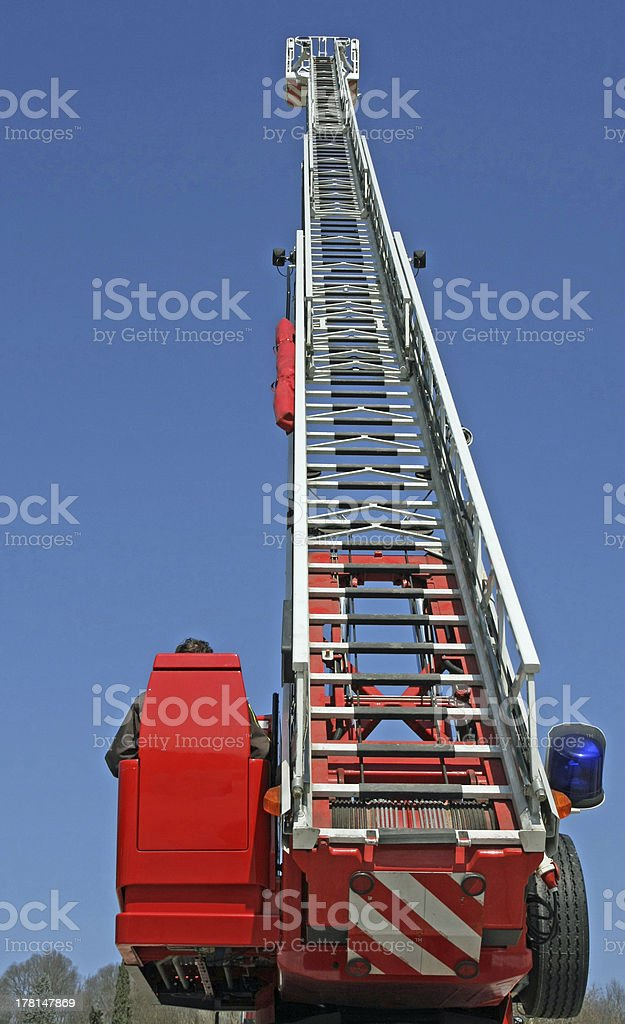 stair riser and blue truck Siren of firefighters royalty-free stock photo
