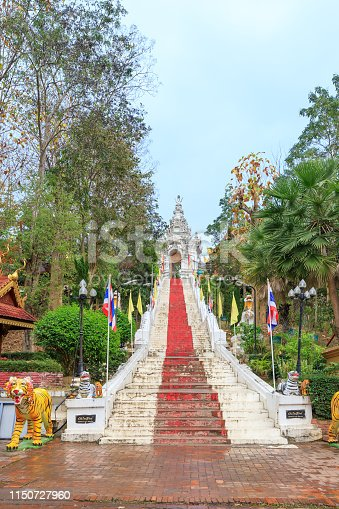 909806032istockphoto Stair to Golden pagoda for year of tiger at  Wat Prathat Cho Hae Temple, Phrae, Thailand. 1150727960