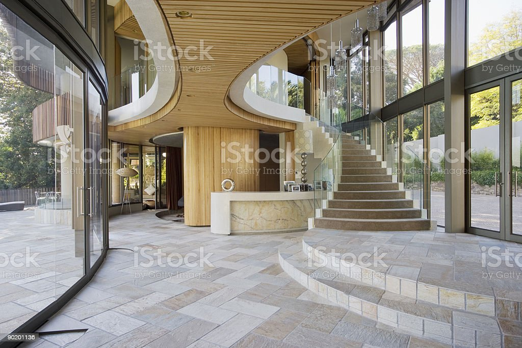 Staircase and entryway of modern home stock photo