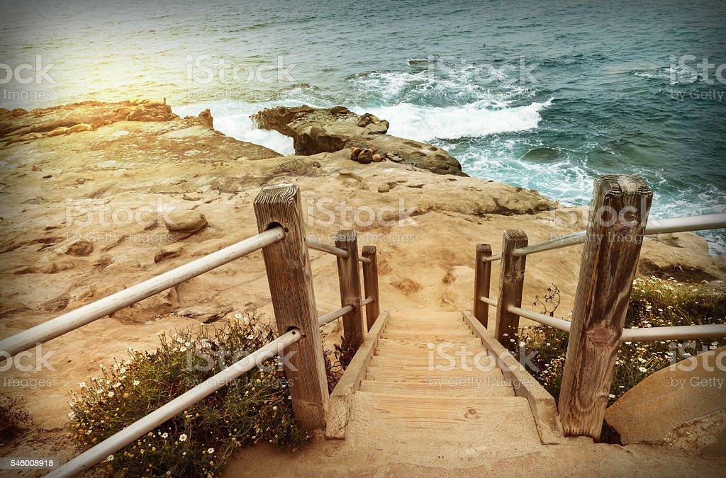 Staircase down to beach, California stock photo