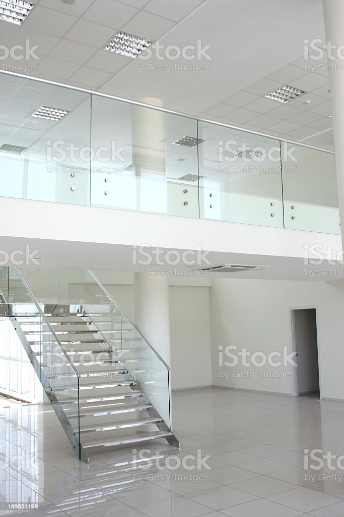 A staircase in an empty white modern architectural home stock photo