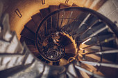 Low angle shot of a spiral staircase.