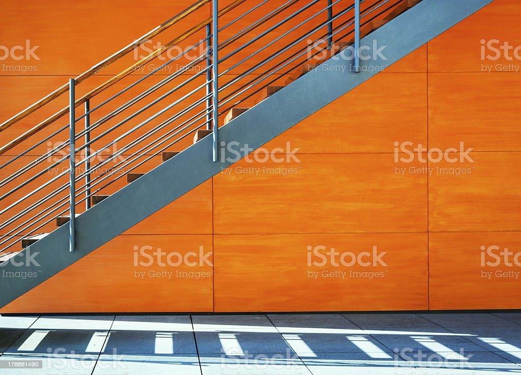Staircase of modern house with orange walls royalty-free stock photo