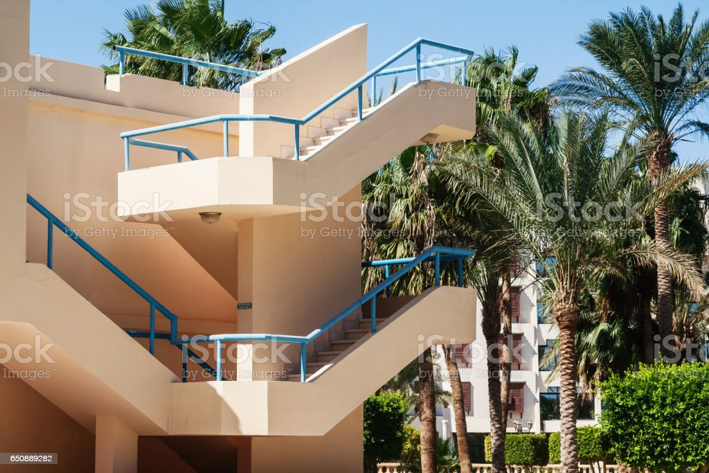 staircase outside in a villa hotel with palm tree in Egypt stock photo