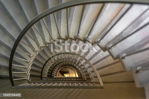 A staircase winding down a building